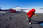 Secretary Kerry Leans Into a Stiff Wind as he Walks Away From a National Science Foundation Helicopter, After Flying to Cape Royds, Antarctica (30279237874).jpg