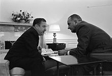 Russell B. Long and Lyndon B. Johnson talking over a table