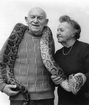 Jerusalem Biblical Zoo - Aharon Shulov and his wife, Yocheved, holding a python.