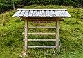 Sign by mountain lodge Tomčeva koča, Karawanks, Slovenia 23.jpg