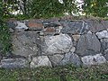 Skogskyrkogarden CementeryWall2.jpg
