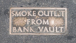 Frangibility - A plaque marking the frangible section of a London pavement.
