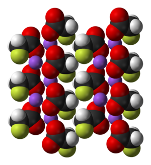 Sodium fluoroacetate - Multiple sodium fluoroacetate molecules arranged in a crystal. Fluorines are shown in green, sodium purple, oxygen red.