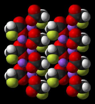 Sodium fluoroacetate - Multiple sodium fluoroacetate molecules arranged in a crystal. Fluorines are shown in green, sodium purple, oxygen red.
