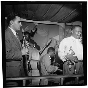 Jimmy Jones (pianist) - Sol Yaged, John Levy, Jimmy Jones, and Rex Stewart, Pied Piper, New York, c. September 1946  Photograph by William P. Gottlieb