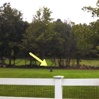 "Southwick, Massachusetts - A stake marks the southernmost point in the ""Southwick jog"" of the Massachusetts-Connecticut boundary. Seen from East Street in Granby, CT."