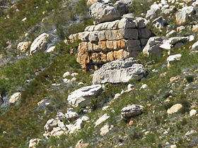 Stack of split sandstone below Cedarberg sandstone cliff.jpg