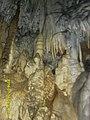 Stalactites, stalagmites and stalagnates of the Azish cave. Abkhazia. Russia.jpg
