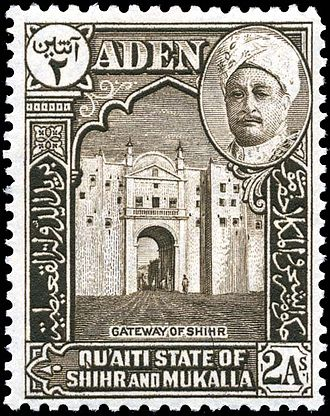 Tarim, Yemen - A Qu'aiti postage stamp of 1942 depicts Sultan Saleh and the city gate of Ash Shihr.