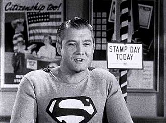 George Reeves - Screen capture of Reeves as Superman in the U.S. government film Stamp Day for Superman