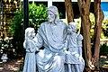 Statue of Jesus seated among children.jpg