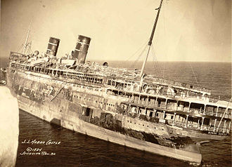 SS Morro Castle (1930) - SS Morro Castle after the fire; photo taken from the seaward end of the Asbury Park Convention Hall pier, November 1934.