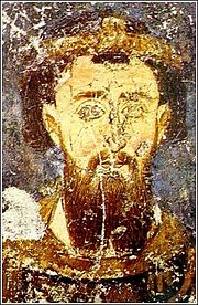 Slightly damaged painting of a bearded middle-aged man, wearing a golden diadem