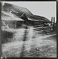 Stereoscopic picture of a traditional barn used for drying and threshing grain, right image (34184769374).jpg