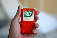 A large packet of orange flavored Tic Tacs
