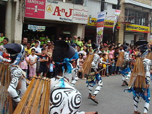 Tacloban - Street performers carrying taklub on their backs (Tacloban takes its name from the taklub, a bamboo fish-catching contraption).
