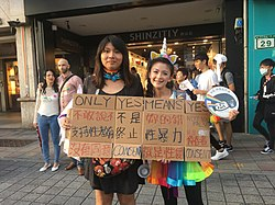 Participants at a pride rally in Taiwan holding a placard discussing sexual consent. Image: Evelyn Liu.