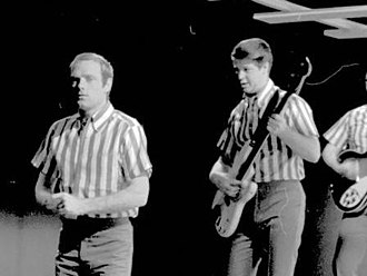 Mike Love - Love (left) performing with the Beach Boys, 1964