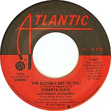 "The cover of a 45 R.P.M. single published by Atlantic Records. The song is ""The Closer I Get to You"" by Roberta Flack with Donny Hathaway"
