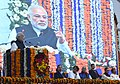"The Prime Minister, Shri Narendra Modi addressing the Public Meeting, after the ""Bhumi Pujan"" for redevelopment of Gandhinagar Railway Station Complex, in Gujarat.jpg"