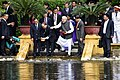 The Prime Minister, Shri Narendra Modi and the Prime Minister of the Socialist Republic of Vietnam, Mr. Nguyen Xuan Phuc feed fish in Uncle Ho's pond, in the Presidential Place Compound, in Hanoi, Vietnam (2).jpg