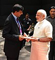 The Prime Minister, Shri Narendra Modi being received by the Governor of Reserve Bank of India, Shri Raghuram Rajan at the Financial Inclusion Conference of RBI, in Mumbai on April 02, 2015 (1).jpg