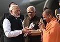 The Prime Minister, Shri Narendra Modi being welcomed by the Governor of Uttar Pradesh, Shri Ram Naik and the Chief Minister of Uttar Pradesh, Yogi Adityanath, on his arrival, in Lucknow, Uttar Pradesh on February 21, 2018.jpg