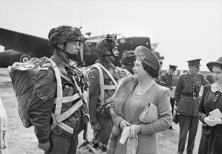The Queen and Princess Elizabeth talk to paratroopers preparing for D-Day, 19 May 1944 The Queen and Princess Elizabeth talk to paratroopers in front of a Halifax aircraft during a tour of airborne forces preparing for D-Day, 19 May 1944. H38612.jpg