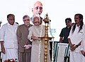 The Vice President, Shri M. Hamid Ansari lighting the lamp at the inauguration of the 2nd stage of the total e-Literacy and commencement of the Digital Libraries programmes, in Kerala, Thiruvananthapuram.jpg