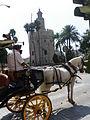 Torre del Oro y coche de caballos.jpg
