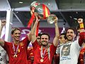 Torres, Mata and Ramos Euro 2012 trophy 01.jpg