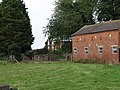 Traditional brick built barn with Morton Hall behind - geograph.org.uk - 532696.jpg