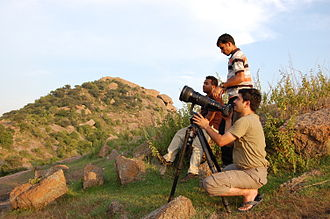 Tripod (photography) - Photographers with heavy telephoto lens attachments use a tripod to stabilize their camera to get sharp images