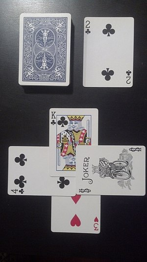 "Trump (card games) - The drawn trump suit is a club card (2 of clubs). South leads sloughs with a 3 of Hearts, West attempts to trump with a 4 of Clubs, North raises the trump with a King of clubs, and East plays a ""Little"" Joker for the win."