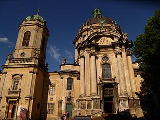 "Soli Deo gloria - Main facade of the Dominican Church in Lviv with Latin the phrase ""Soli Deo honor et gloria""."