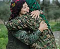 Two YPJ fighters hug.jpg