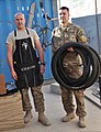 U.S. Air Force Tech. Sgt. Juan Sanchezduarte, left, and Senior Airman Mark Zorich, both assigned to the 451st Expeditionary Logistics Readiness Squadron, pose with bicycle tires outside a bike repair shop 131111-F-BY961-023.jpg