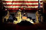 U.S. Airmen assigned to the 1st Special Operations Security Forces Squadron pay tribute to a Prisoner of War-Missing in Action display during the senior noncommissioned officer induction ceremony in 130724-F-HG908-208.jpg