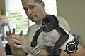 U.S. Army Capt. John Turco, a veterinarian with the 719th Medical Detachment Veterinary Services based in Fort Sheridan, Ill., explains how to care for the bandages of the baby howler monkey to Panamanian 130606-Z-IE813-3763.jpg