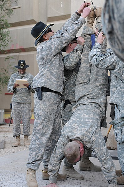 File:U.S. Army Col. Craig Collier does a handstand as he receives his spurs at Forward Operating Base Loyalty in Baghdad, Iraq, (December 2008).jpg