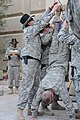 U.S. Army Col. Craig Collier does a handstand as he receives his spurs at Forward Operating Base Loyalty in Baghdad, Iraq, (December 2008).jpg
