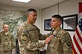 U.S. Army Maj. Gen. Stephen J. Townsend, left, the commander of Combined Joint Task Force 10 and Regional Command East, gives a Purple Heart to Spc. Kelii Torres, a forward observer assigned to Headquarters 140905-A-DS387-022.jpg