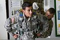 U.S. Army Staff Sgt. Dan Cisneros, a squad leader with the 2nd Squadron, 38th Cavalry Regiment, 504th Battlefield Surveillance Brigade, is fitted with a parachute before the squadron's first airborne operation 140415-A-ZZ999-001.jpg