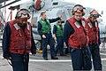 U.S. Navy Chief Damage Controlman Corey Williams, left, Electronics Technician 1st Class Michael Krebs, center, and Information Technician Seaman Leroy Lopez, assigned to the littoral combat ship USS Freedom 130523-N-PD773-017.jpg