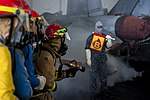 U.S. Sailors fight a simulated fire during a general quarters drill in the hangar bay of the aircraft carrier USS Harry S. Truman (CVN 75) March 8, 2014, in the Gulf of Oman 140308-N-VE959-066.jpg