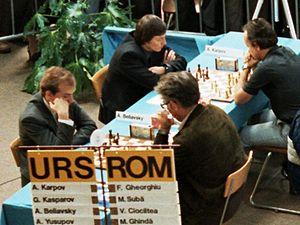 Florin Gheorghiu - Gheorghiu (far right) playing against Anatoly Karpov