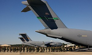 Rapid deployment force - 82d Airborne Division Paratroopers board transport aircraft