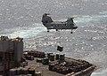 US Navy 020909-N-1082Z-001 CH-46 transports ammunition to USNS Supply.jpg