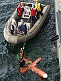 US Navy 030504-N-0507C-018 USS O'Bannon (DD 987) boat crew assists a rescue swimmer in recovering a remote-controlled drone.jpg