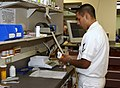 US Navy 030819-N-9593R-104 Hospital Corpsman 3rd Class Michael Dominguez, of Denver, CO., labels a prescription in the pharmacy at the National Naval Medical Center in Bethesda, Maryland.jpg